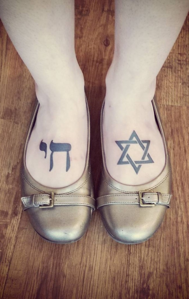 Star of David and Hebrew Chai symbol dark black ink tattoo on both foot