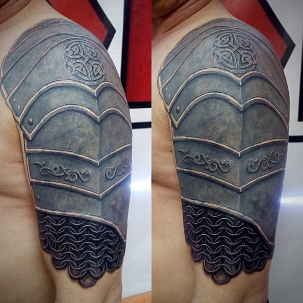 Steel like colored shoulder armor tattoo stylized with Celtic symbol