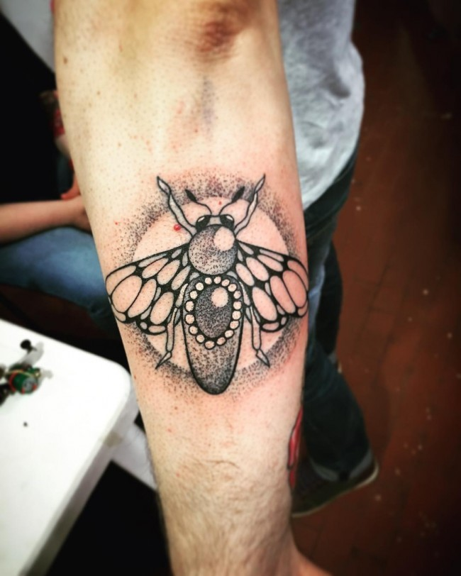 Stippling style beautiful looking forearm tattoo of bee with jewelry
