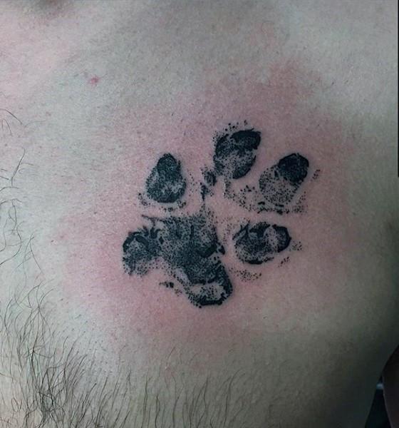Stippling style black ink animal paw print