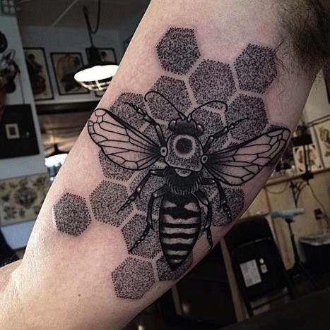 Stippling style black ink biceps tattoo of big bee with ornaments
