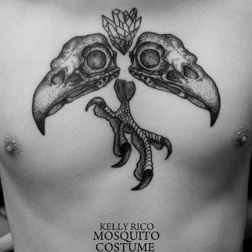 Stippling style black ink chest tattoo of eagle skulls with leg