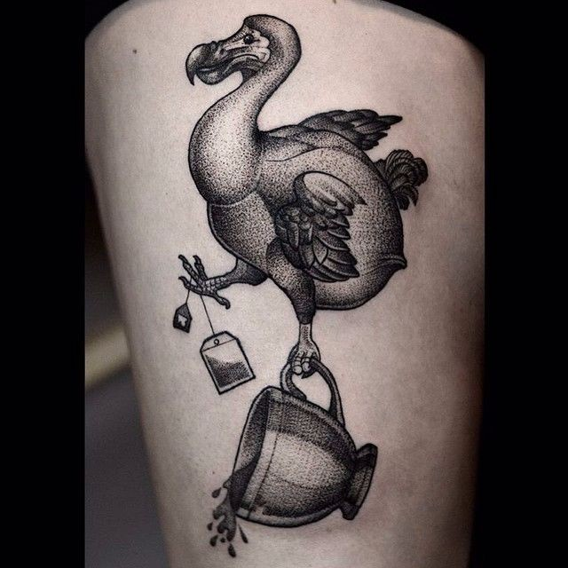 Stippling style black ink thigh tattoo of funny bird with tea bag and cup