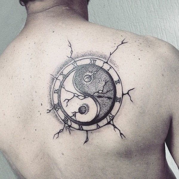 Stippling style Yin Yang symbol tattoo on back stylized with clock