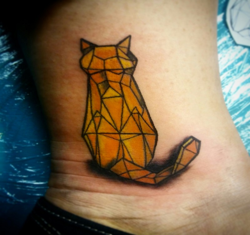 Stone like colored small cat tattoo on ankle
