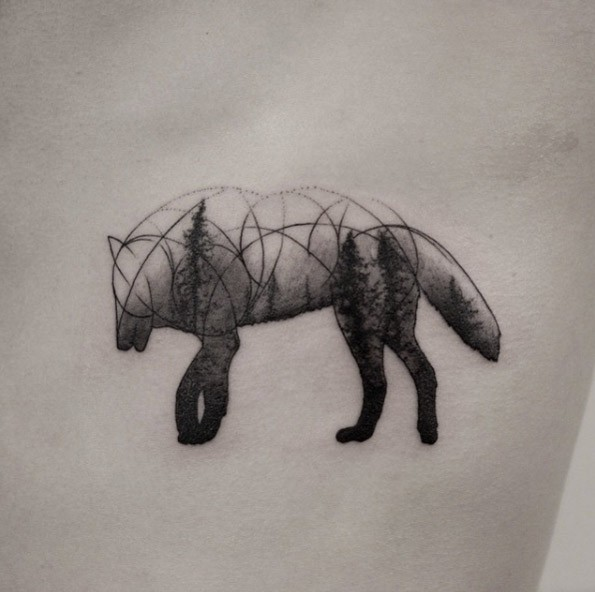 Strange looking black ink small wolf shaped tattoo stylized with forest trees