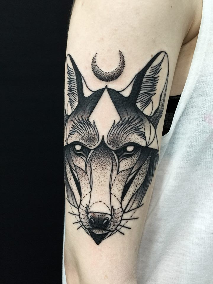 Stunning dotwork style painted by Michele Zingales upper arm tattoo of wolf head with moon