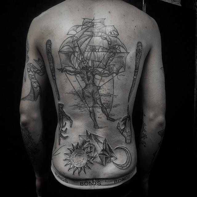 Stunning dotwork style whole back tattoo of strange combined mystical symbols