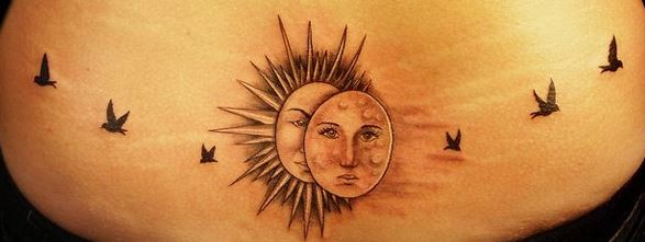 Sun and moon with birds tattoo on lower back