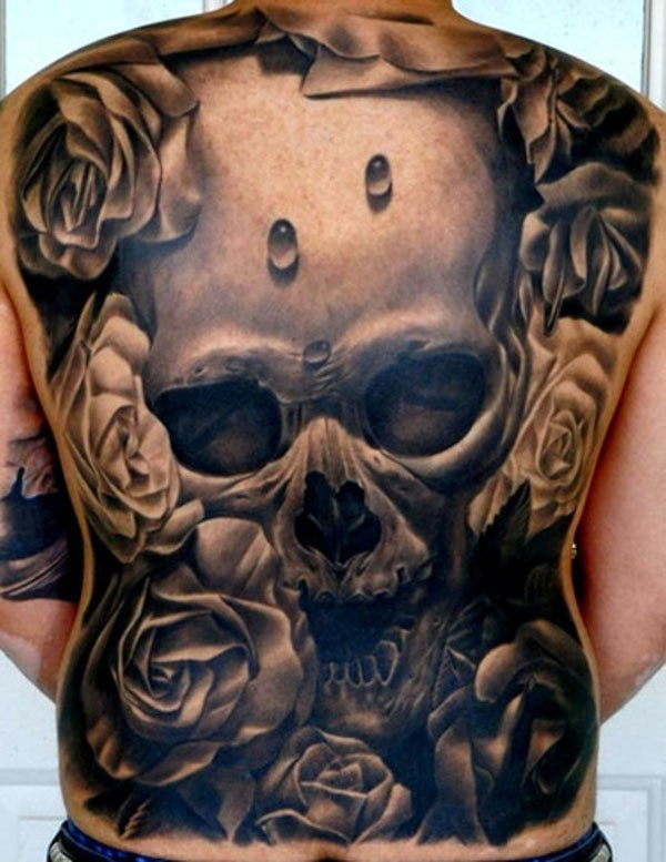 Super realistic skull and roses tattoo on whole back