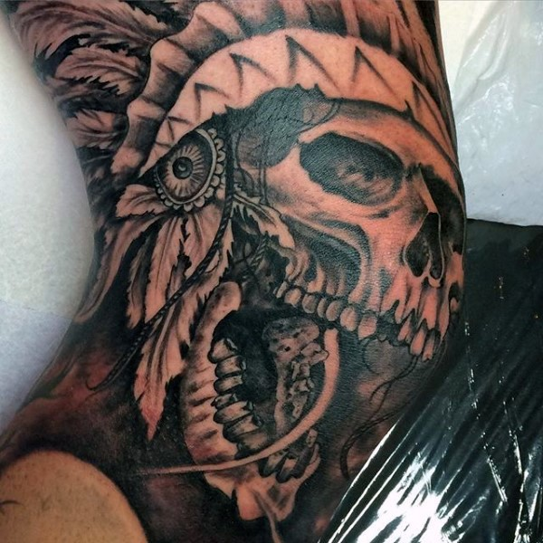 Superior black ink elbow tattoo of Indian skull