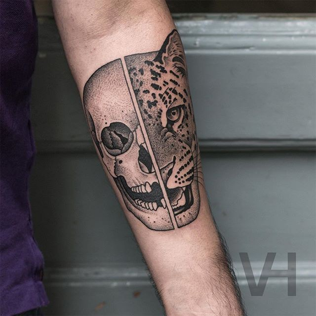 Superior painted by Valentin Hirsch forearm tattoo of split human skull and leopard head