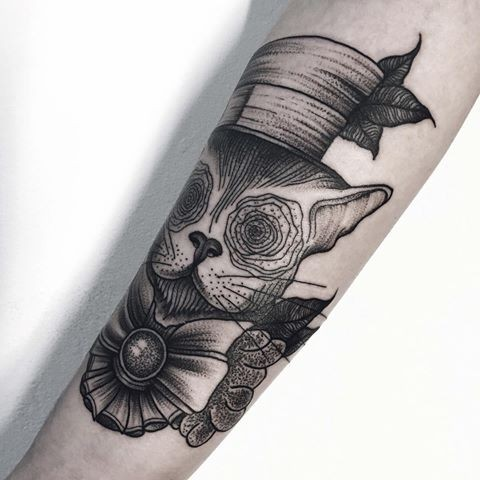 Surrealism like dot style arm tattoo of mystical cat with funny hat and bow