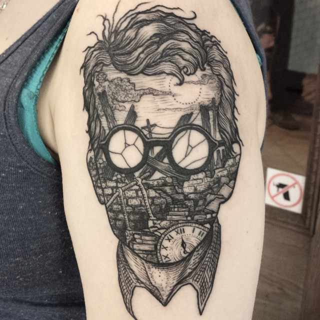 Surrealism style black ink shoulder tattoo of creepy man in sun glasses