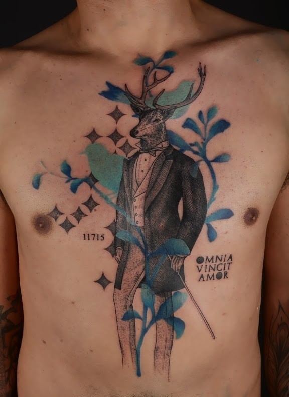 Surrealism style colored chest tattoo of deer in suit with lettering