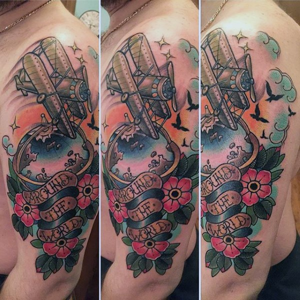 Sweet looking colored shoulder tattoo of flying plane flowers and lettering