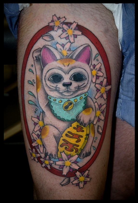 Sweet looking colored thigh tattoo of Asian lucky cat and flower s