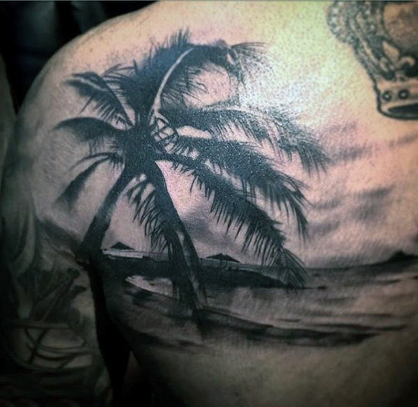 Sweet painted black ink island ocean shore tattoo with palm tree on shoulder