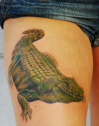 Realistic alligator coloured tattoo on hip