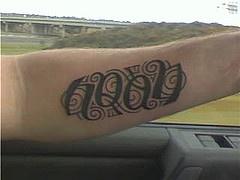 Name noah ambigram tattoo on hand