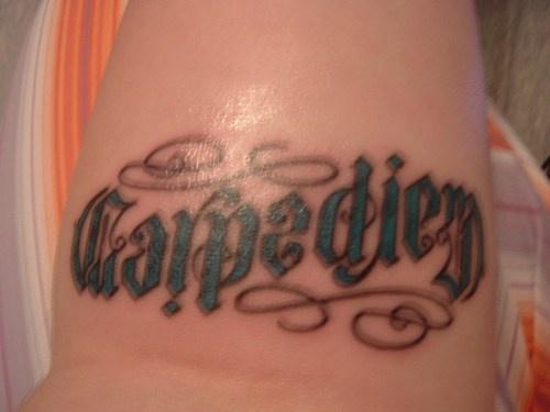 Carpe diem ambigram tattoo in latin