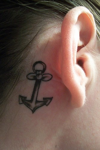 Little female anchor tattoo behind ear