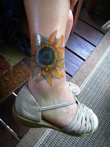 Designed sun-flower ankle tattoo