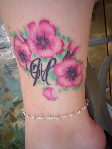Pink beautiful flowers ankle tattoo