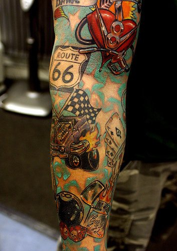 Route 66 cars and flame full sleeve tattoo