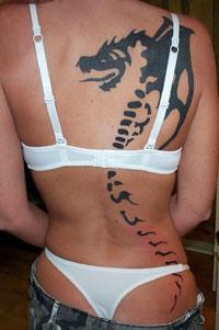 Large bone dragon black ink tattoo