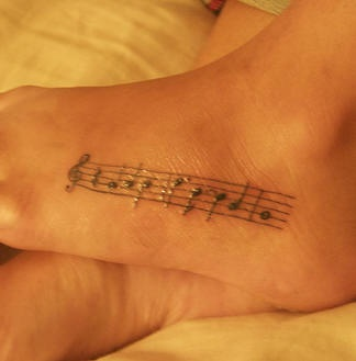Some melody , music foot tattoo