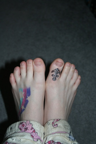 Stars & anchor on big toe foot tattoo
