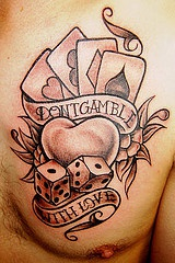 Aces and dice on gamblers love tattoo