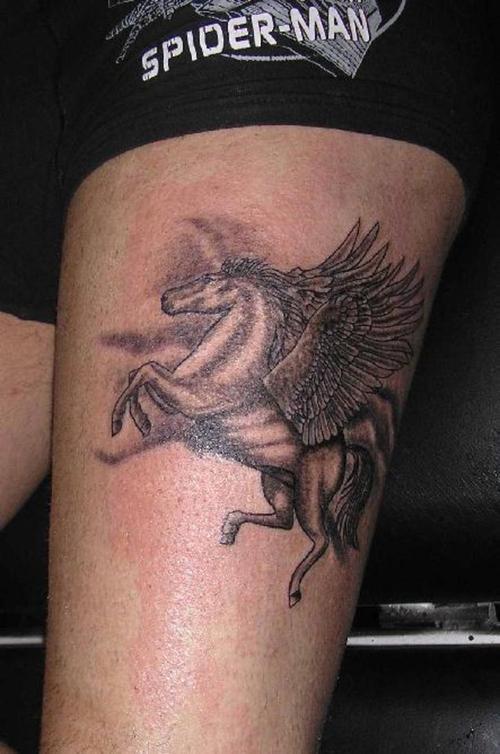 Black pegasus tattoo on hip
