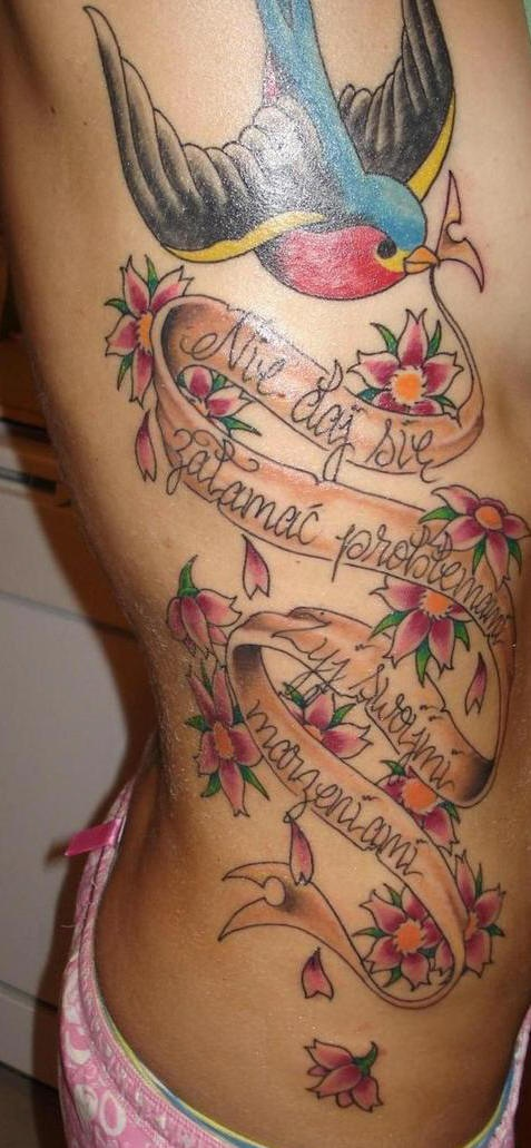 Large side tattoo, swallow holding stripe with inscription