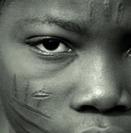 Traditional  scarification marks on face