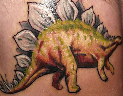 Stegosaurus dinosaur realistic coloured tattoo