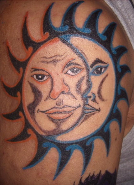Humanized sun and moon tattoo on shoulder