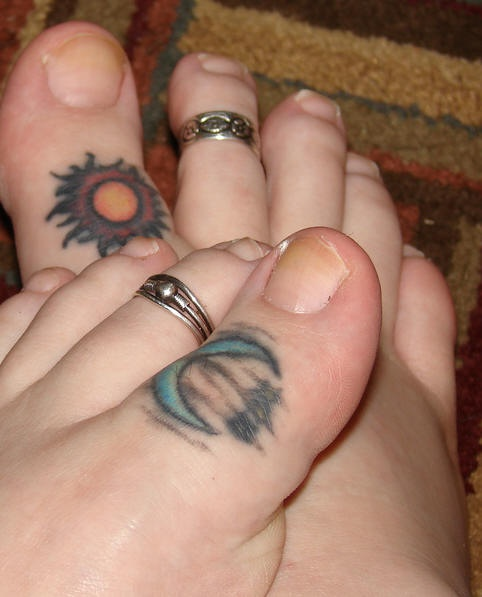 Colourful little sun and moon toe tattoo