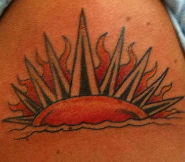 Flaming Sunset coloured tattoo