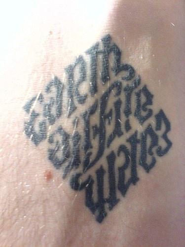 Ambigram earth gift is water tattoo in rhomb