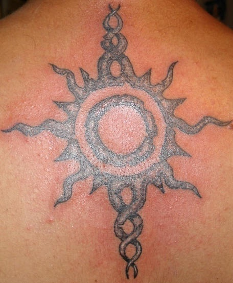 Tribal sun symbol tattoo