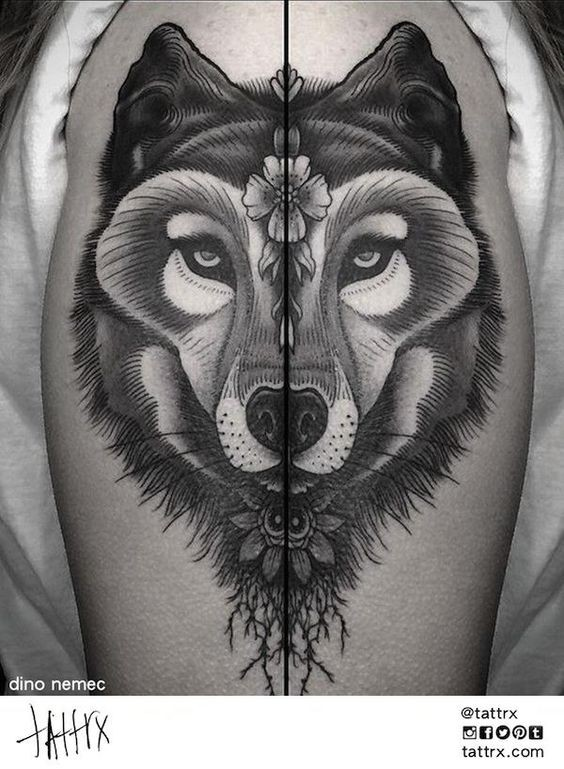 Tattoo painted by Dino Nemec upper arm tattoo of wolf with flowers