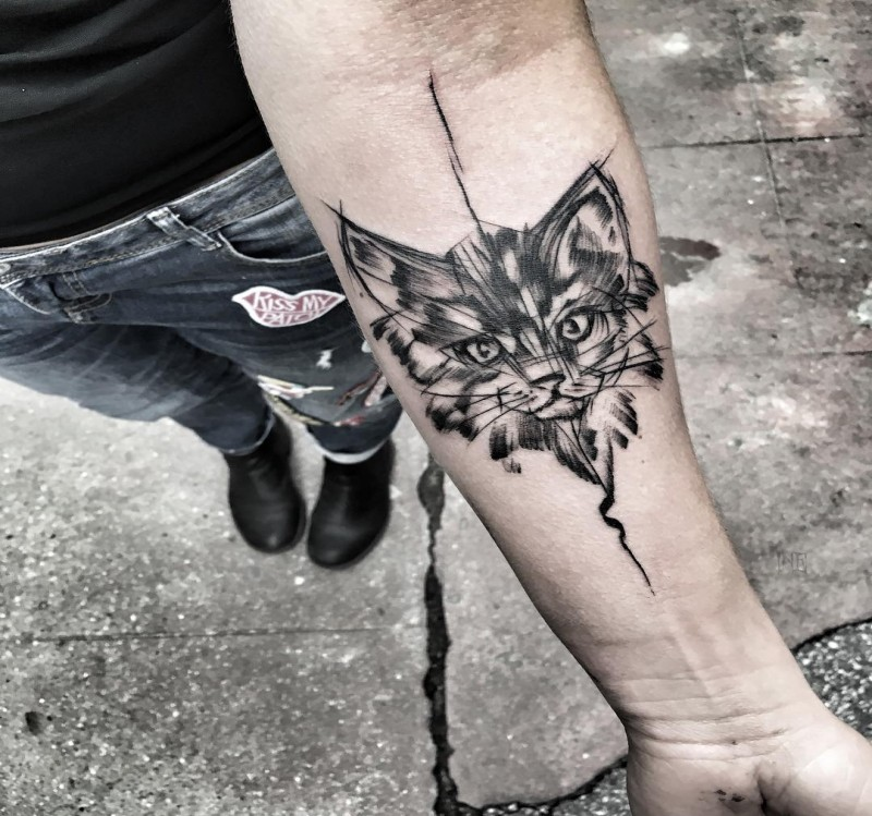 Tattoo sketch designed by Inez Janiak of cute cat head on forearm