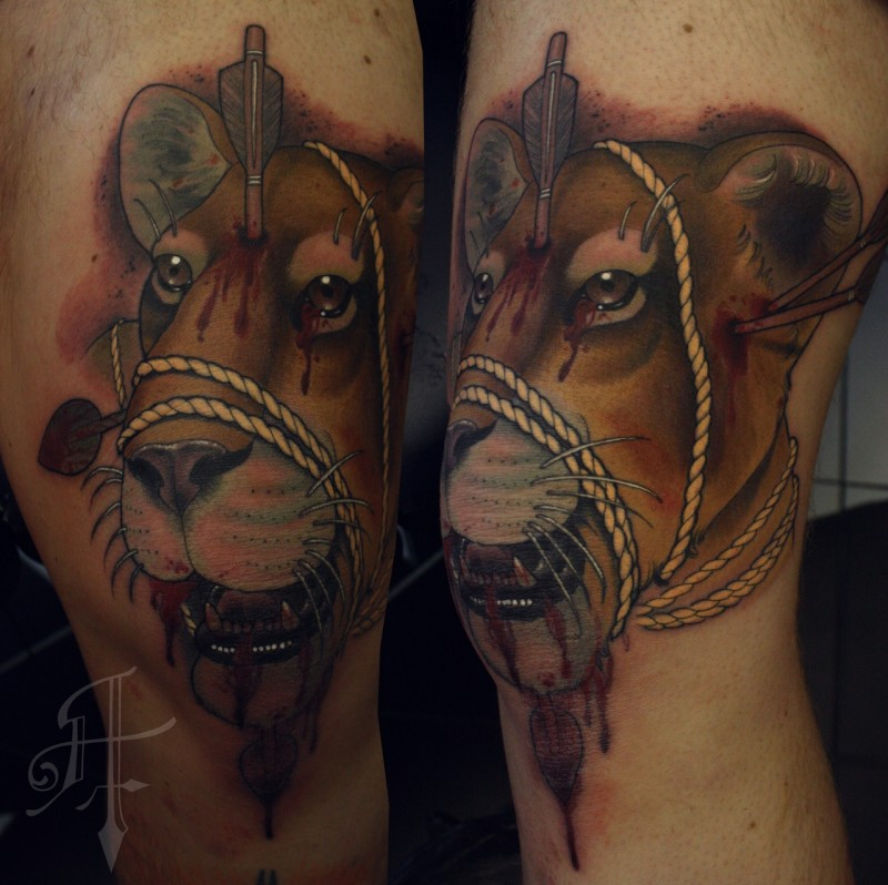 Terrifying colored hand tattoo of bloody lion with arrow and rope
