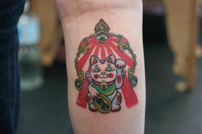 Tine illustrative style colored tattoo of funny maneki neko japanese lucky cat with mystical eye symbol