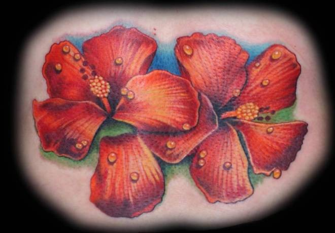 Two hibiscus flowers with dew drops tattoo by Krystof