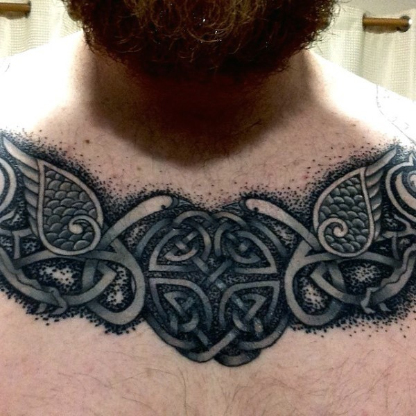 Typical black and white chest tattoo of Celtic symbol