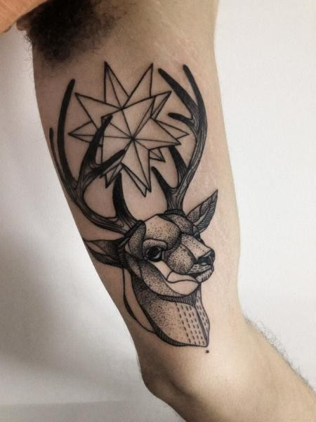 Typical blackwork style painted by Michele Zingales biceps tattoo of deer head with star