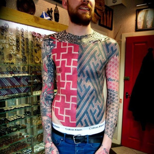 Typical multicolored geometric style tattoo on chest